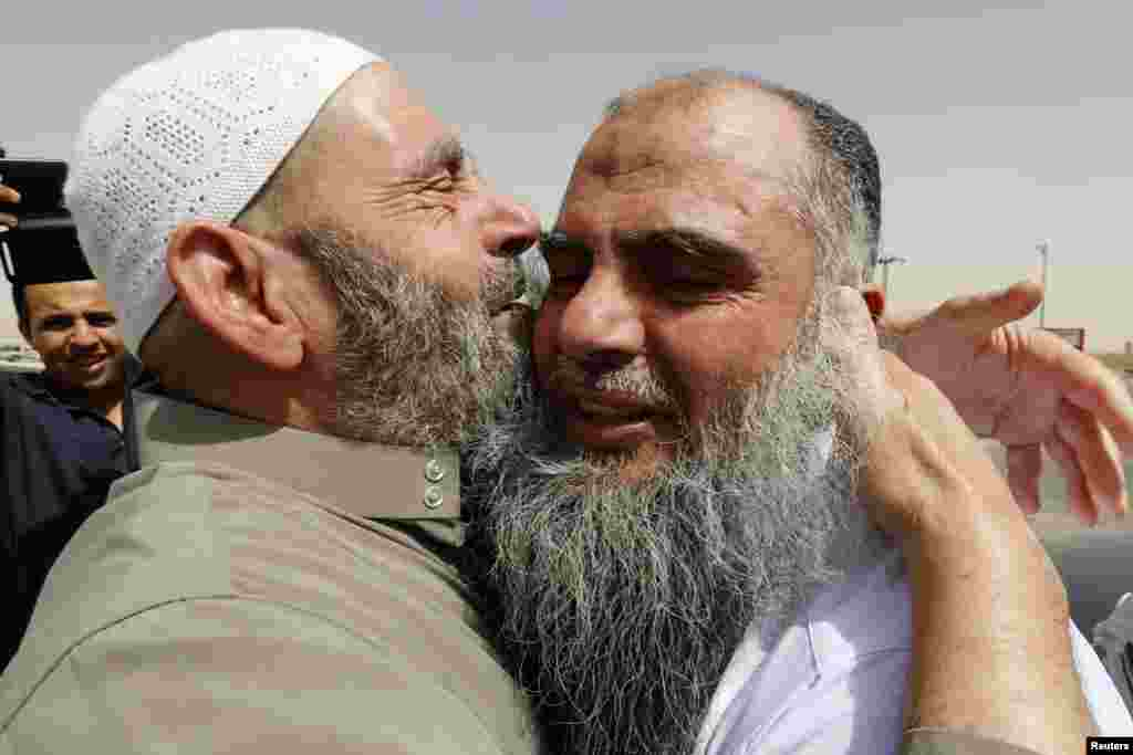 Abu Qatada hugs his father after being released from Mwaqar 2 prison near Amman, Sept. 24, 2014.