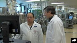 Human Genome Sciences' Barry Labinger (right) says his company has developed an anti-lupus drug that directly targets the autoimmune disorder.