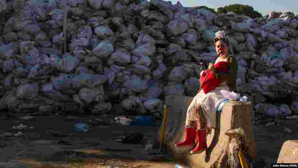 Clown Me In member Sara Berjawi, who goes by the clown name Ziza, prepares to film a Valentine's Day video that hopes to draw awareness to Lebanon's trash crisis, at a dump site on the outskirts of Beirut.