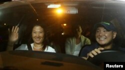 FILE - Keiko, Sachi and Hiro Fujimori, daughters and son of former President Alberto Fujimori arrive to visit their father after Peruvian President Pedro Pablo Kuczynski pardoned him, at Centenario hospital in Lima, Peru, Dec. 24, 2017.