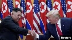 美國總統特朗普與北韓領導人金正恩會晤資料照。