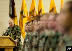 FILE - H.R. McMaster, then the regimental commander, looks to the soldiers during the 3rd Armored Cavalry Reenlistment Ceremony at Waller Gym at Fort Carson in Colorado Springs, Colo., Dec. 1, 2004.
