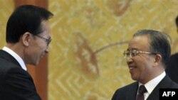 Ли Мен Бак и Дай Бингуо