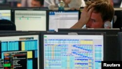 FILE - Traders react as European stock markets open early June 24, 2016, after Britain voted to leave the European Union.