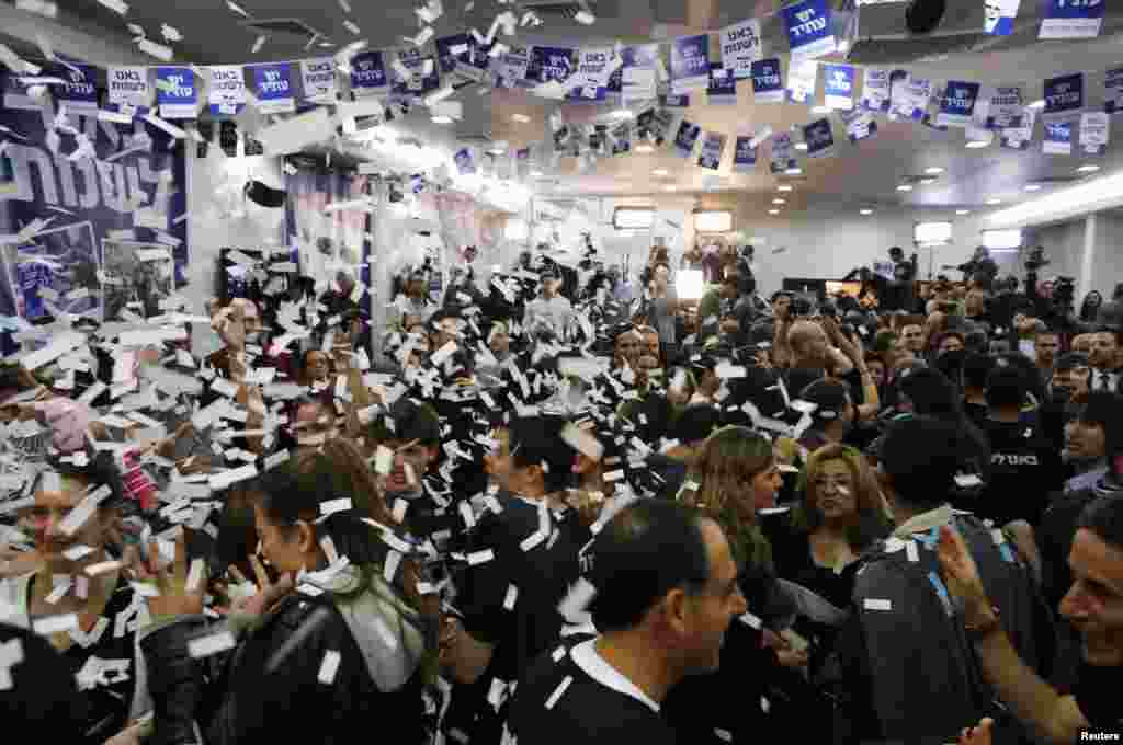 Supporters of Yair Lapid's Yesh Atid (There is a Future) party celebrate at the party's headquarters in Tel Aviv, Israel, January 23, 2013.