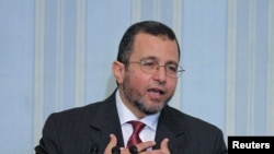 Egypt's new Prime minister, Hisham Qandil, speaks during his first news conference in Cairo, August 2, 2012.
