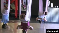 An AntiGravity Yoga class in Los Angeles (VOA - E. Lee).