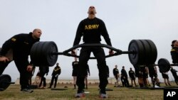 U.S Army 1st Lt. Mitchel Hess participates in a weight lifting drill while preparing to be an instructor in the new Army combat fitness test at Fort Bragg, N.C., Jan. 8, 2019. The new test is designed to be a more accurate test of combat readiness.