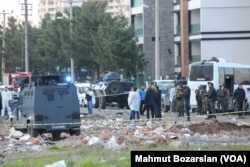 FILE - A car bomb explosion killed 7 policemen in Diyarbakir, March 31, 2016. Months of fighting between the Kurdish rebels and Turkish security forces has devastated the city.