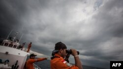 Indonesian national rescue personnel conduct search for missing Malaysia Airlines flight MH370, Andaman Sea, March 15, 2014.