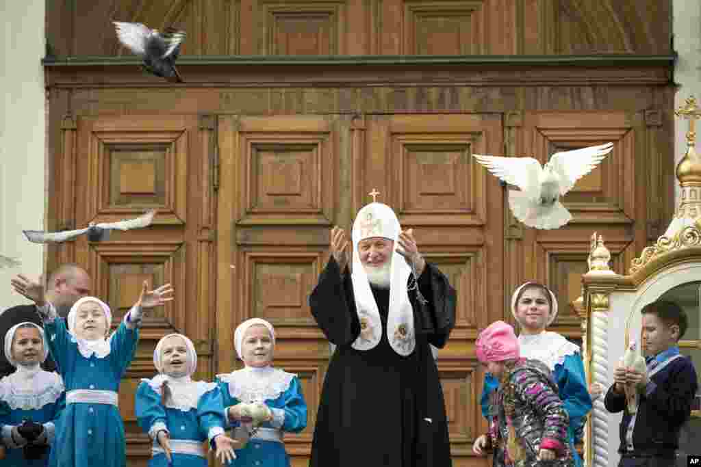 Russian Orthodox Church Patriarch Kirill releases birds at Annunciation Cathedral in the Moscow's Kremlin in Moscow, Russia.