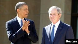 """FILE - U.S. President Barack Obama applauds as former President George W. Bush arrives on stage at the dedication ceremony for the George W. Bush Presidential Center in Dallas, April 25, 2013. Taunted by Republicans to declare war on """"radical Islamic terrorism,"""" Democrats are turning to an unlikely ally: George W. Bush."""