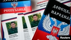 Election information sheets are displayed with portraits of Alexander Zakharchenko, separatist leader of the self-proclaimed Donetsk People's Republic, during preparations for the upcoming election in Donetsk, eastern Ukraine.