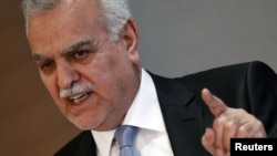 Iraq's fugitive Vice President Tareq al-Hashemi gestures as he addresses the media in Ankara, September 10, 2012.