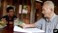 Thet Sambath, filmmaker of the 'Enemies of the People', talking to former Khmer Rouge leader Nuon Chea, file photo.