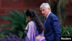 U.S. Secretary of Defense Chuck Hagel (R) arrives for a meeting with India's Foreign Minister Sushma Swaraj (not pictured) in New Delhi, August 8, 2014.