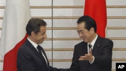 日本首相菅直人欢迎法国总统萨科齐