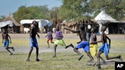 FILE - In this photo taken Dec. 8, 2017, boys play a game of soccer in Jiech, Ayod County, South Sudan.