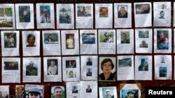 Photos of some of those killed are posted at a memorial in Kyiv's Independence Square on Feb. 25, 2014.