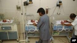 FILE - In this file photo taken Oct. 4, 2006, Pakistani hospital staff members attend newly born babies in Karachi, Pakistan. (AP Photo/Shakil Adil, File)