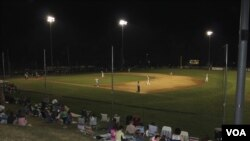 Fans gather to watch the Orleans Firebirds during the Cape Cod Baseball League's summer season. (VOA/D. Gruenbaum)