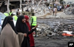 FILE - Somali women react at the scene of a deadly blast in Mogadishu, Somalia, Oct. 15, 2017.