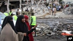 Somali women react at the scene of Saturday's blast, in Mogadishu, Somalia, Oct. 15, 2017.