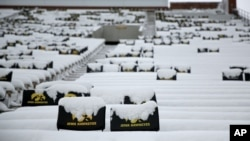 Snow blankets the stand at Kinnick Stadium before the start of Iowa's NCAA college football game against Purdue in Iowa City, Iowa, Nov. 21, 2015.
