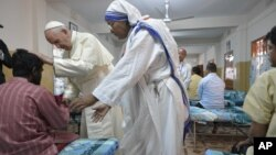 Pope Francis greets and blesses one of the guests of the Mother Teresa House in the Dhaka's Tejgaon neighborhood, Bangladesh, Dec. 2, 2017.