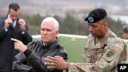 U.S. Vice President Mike Pence, left, is briefed by U.S. Gen. Vincent Brooks, right, commander of the United Nations Command, U.S. Forces Korea and Combined Forces Command from Observation Post Ouellette in the Demilitarized Zone (DMZ).