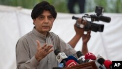 "FILE - Pakistani Interior Minister Chaudhry Nisar Ali Khan speaks to reporters in Islamabad, Sept. 23, 2016. He said Friday that as a ""goodwill gesture"" Pakistan would removed Cyril Almeida's name from a travel ban."