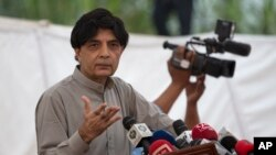 """FILE - Pakistani Interior Minister Chaudhry Nisar Ali Khan speaks to reporters in Islamabad, Sept. 23, 2016. He said Thursday that the government was trying to find out who gave """"incorrect information"""" to newsman Cyril Almeida."""