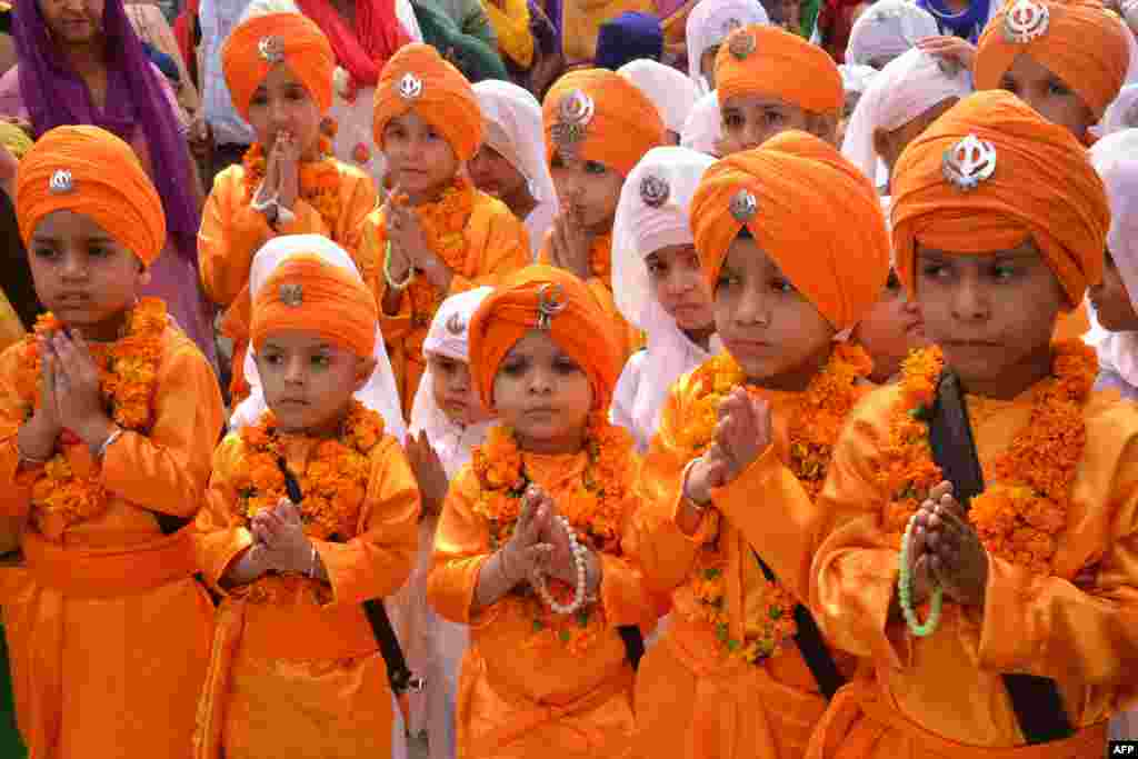 Indian Sikh school children dressed as Punj Pyara participate in a march from the Sri Akal Takhat at the Sikh Shrine, the Golden Temple in Amritsar, on the eve of the birth anniversary of the fourth Sikh Guru Ramdass.