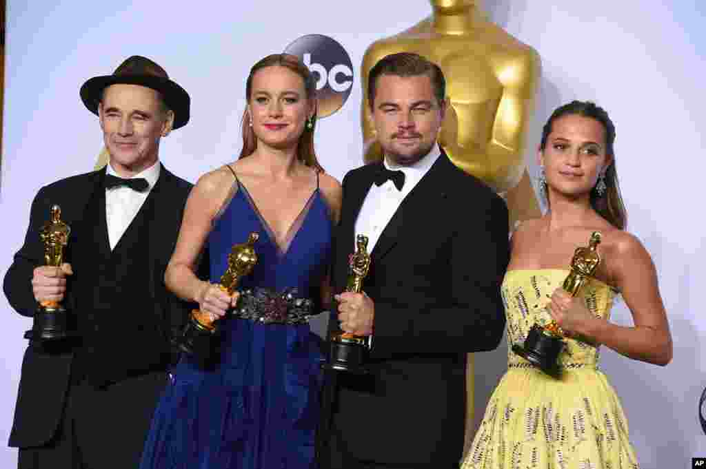 "Mark Rylance, winner of the award for best actor in a supporting role for ""Bridge of Spies,"" from left, Brie Larson, winner of the award for best actress in a leading role for ""Room"", Leonardo DiCaprio, winner of the award for best actor in a leading rol"