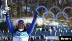 Gold medallist Marit Bjoergen of Norway celebrates on the podium after winning the gold medal in the women's 30k cross-country skiing competition at the 2018 Winter Olympics in Pyeongchang, South Korea, Feb. 25, 2018. Bjoergen won five medals at the Pyeongchange Games.