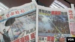 台湾媒体头条报道香港警方对抗议民众使用催泪弹(美国之音张永泰拍摄)
