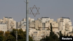 A general view shows a Star of David near buildings in the Israeli settlement of Maale Edumim, in the occupied West Bank, Dec. 28, 2016.