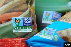 FILE - Labels on bags of snack foods indicate they are non-GMO products, Los Angeles, California, Oct. 19, 2012.