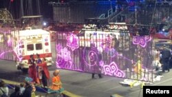 Emergency personnel attend to Ringling Bros. and Barnum & Bailey Circus performers who were injured when the scaffolding they were performing from collapsed in Providence, Rhode Island, May 4, 2014.