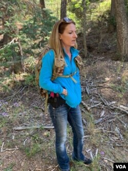 Sacha Johnston, a single mother and real estate agent, is scouring the landscape of the Black Canyon Campground north of Santa Fe, New Mexico, in search of a hidden treasure. (VOA/Penelope Poulou)