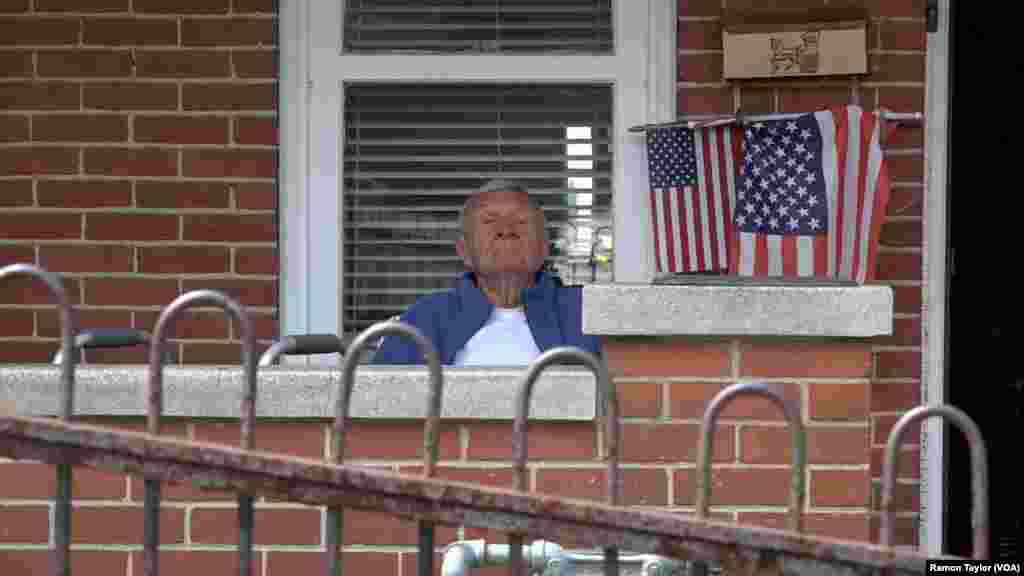 Retired steelworker Richard Check rests outside his home in Bethlehem, Pennsylvania, April 22, 2016.