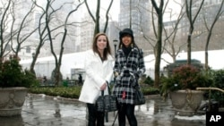 Brittney Paulson (left) and Arianna Janelle Moultrie (right), grand prize winners of the Passion for Fashion Competition 2010, attended New York City Fashion Week.