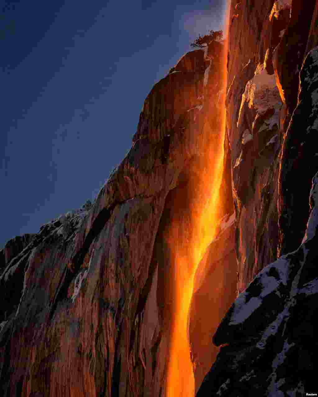 "In this photo from social media, sunlight hits Horsetail Fall, making it look like a ""firefall"" at Yosemite National Park in California."