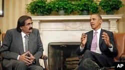 Tổng thống Obama thảo luận tại Phòng Bầu Dục với Quốc vương Qatar Sheik Hamad bin Khaifa al-Thani.