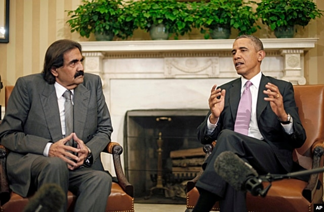 President Barack Obama meets with Emir Sheikh Hamad bin Khalifa Al-Thani of Qatar in the Oval Office of the White House in Washington, April 23, 2013.