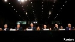 "Left to right, Federal Bureau of Investigation (FBI) Director Christopher Wray; Central Intelligence Agency (CIA) Director Mike Pompeo; Director of National Intelligence (DNI) Dan Coats; Defense Intelligence Agency Director Robert Ashley; National Security Agency (NSA) Director Michael Rogers; and National Geospatial Intelligence Agency Director Robert Cardillo testify before a Senate Intelligence Committee hearing on ""Worldwide Threats"" on Capitol Hill in Washington, Feb. 13, 2018."