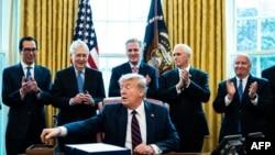 WASHINGTON, DC - MARCH 27: (L-R) Treasury Secretary Steven Mnuchin, Senate Majority Leader Mitch McConnell (R-KY), House Minority Leader Kevin McCarthy (R-CA), Vice President Mike Pence and Rep. Kevin Brady (R-TX) applaud U.S. President Donald Trump…