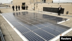 FILE - Solar panels are seen on the roof of the Department of Energy in Washington, March 19, 2015.