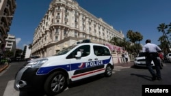 A police car is seen parked outside the Carlton hotel in Cannes, France, July 28, 2013.