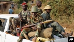 FILE - Seleka rebels are seen driving through Bangui, Central African Republic.